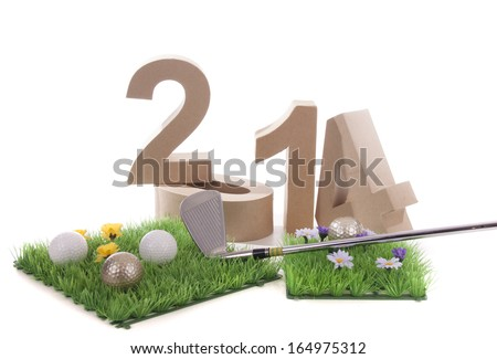 Golfstick and green symbolizes golfsport in the New year - stock photo