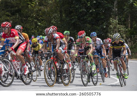 GOMBAK, SELANGOR - MARCH 14 : Big peloton at KM 68, Gombak, Selangor during stage 7 Le Tour de Langkawi 2015 from Shah Alam to Fraser Hill, Pahang Malaysia on March 14, 2015. - stock photo