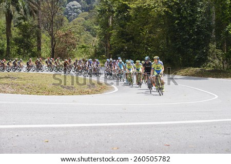 GOMBAK, SELANGOR - MARCH 14 : TINKOFF SAXO(DEN) team leading big peloton at KM 68, Gombak, Selangor in stage 7 Le Tour de Langkawi 2015 from Shah Alam to Fraser Hill, Pahang Malaysia on March 14, 2015 - stock photo