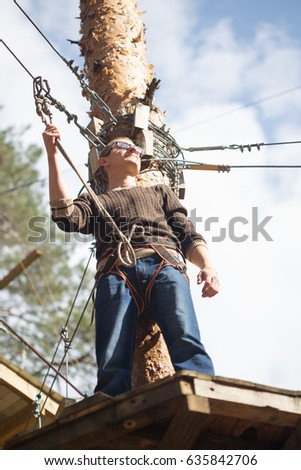 Gomel, Belarus - 30 April, 2017: Rope town for a family holiday in the countryside. Family competition to overcome aerial obstacles