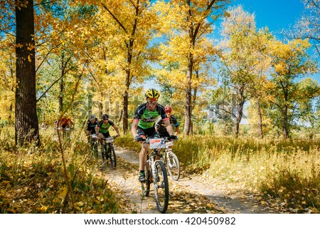 Gomel, Belarus - August 9, 2015: Group Of Young Mountain Bike Cyclist Riding Track At Sunny Day. Mountain Bike Cyclist Riding Track At Sunny Day, Healthy Lifestyle Active Athlete Doing Sport. - stock photo