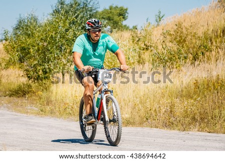 Gomel, Belarus - August 9, 2015: Mountain Bike cyclist riding track at sunny day, healthy lifestyle active athlete doing sport. - stock photo