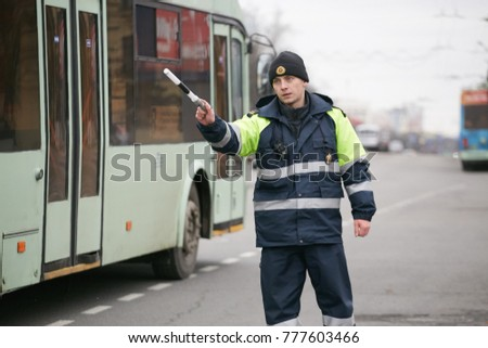 GOMEL, BELARUS - December 18, 2017: Officer of the road patrol service with a baton.