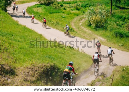 GOMEL, BELARUS - JUNE 7, 2015: Group Of Mountain Bike cyclists riding track at sunny day, healthy lifestyle active athlete doing sport - stock photo
