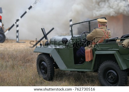Gomel, Belarus - November 26, 2017: Re-enactors Dressed As German Soldiers In WW II Are Fighting With A Cannon. Celebration Of 74 Anniversary Of Liberation Of Gomel From Nazi Invaders