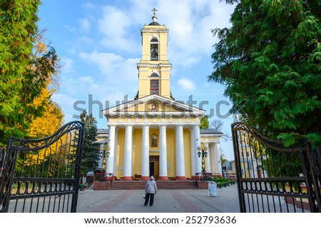 GOMEL, BELARUS - OCTOBER 13, 2014: Unidentified woman stands at the entrance to the Cathedral of Peter and Paul in Gomel, Belarus