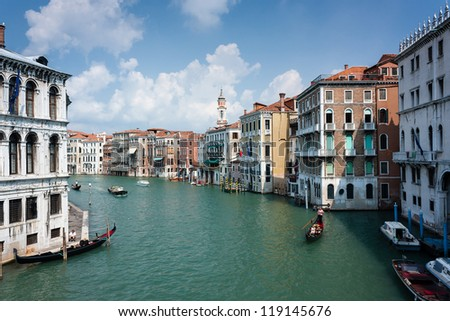 Gondola and other boats move along the Grand Canal in Italy - stock photo
