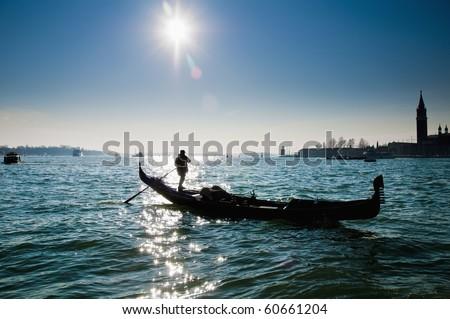 Gondola backlighting as seen at Venice, Italy - stock photo