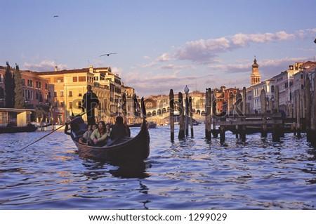 Gondola by Rialto Bridge on the grand canal - stock photo