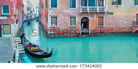 gondola in a Venice green canal