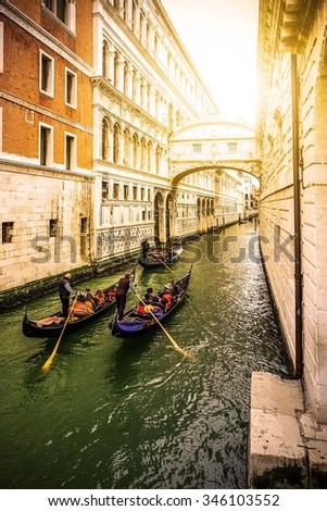 Gondola in Venice on sunset. bridge of sights - stock photo