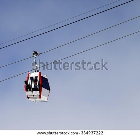Gondola lift with ski and snowboards. Ski resort Gudauri, Georgia. Caucasus Mountains at sun day - stock photo