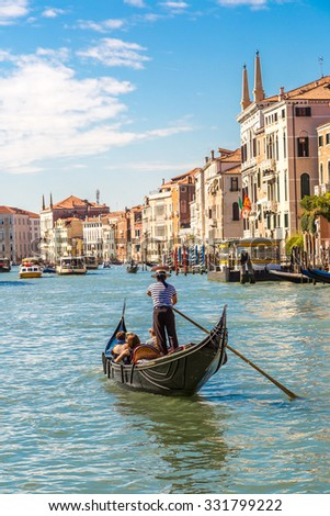 Gondola on Canal Grande in Venice, in a beautiful summer day in Italy - stock photo