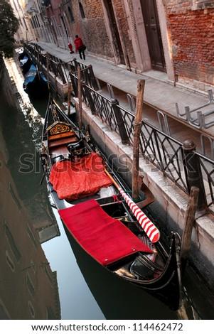 Gondola on canal in Venice, Italy - stock photo
