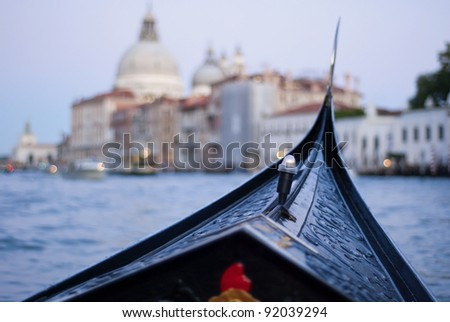 gondola ride during evening on Grand Canal, Venice, Italy, Europe. In the earlier days those famous gondolas were colorful but Napoleon made them change to black - stock photo