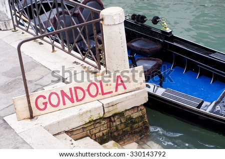Gondola sign at canal in Venice, Italy