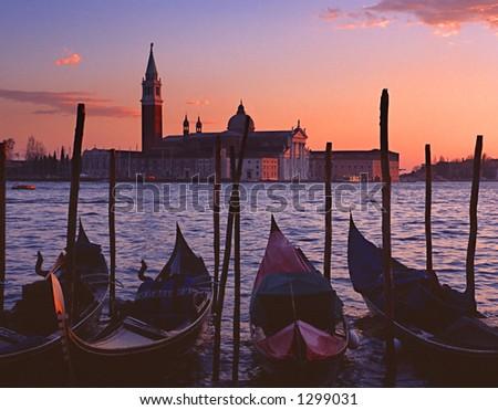 Gondolas by Saint Georgio at sunset - stock photo