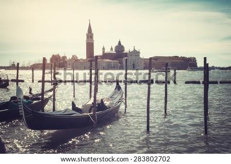 Gondolas docked on Piazza San Marco Venice aged - stock photo