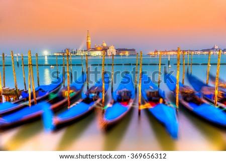 Gondolas in Venice - with San Giorgio Maggiore church. San Marco, Venice, Italy (gondolas intentionally blurred) - stock photo