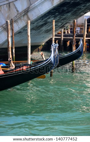 Gondolas moored in the Grand Canal in Venice - stock photo