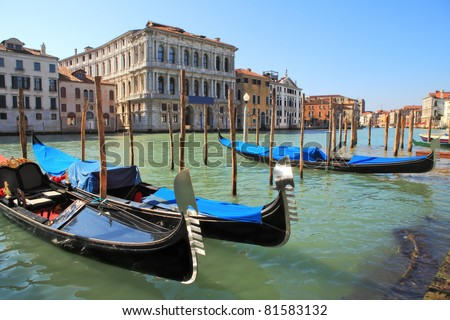 Gondolas on Grand Canal against old historic houses in Venice, Italy. - stock photo