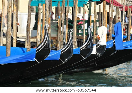 Gondolas parked on Venice's Grand Canal in Italy - stock photo