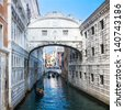 Gondolas passing under the Bridge of Sighs - Ponte dei Sospiri. A legend says that lovers will be granted eternal love if they kiss on a gondola at sunset under the Bridge. Venice, Italy, Europe. - stock photo