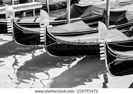 gondolas resting on pier in Venice, Italy - stock photo