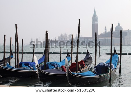 Gondolas tied up along the Grand Canal, Venice, Italy - stock photo