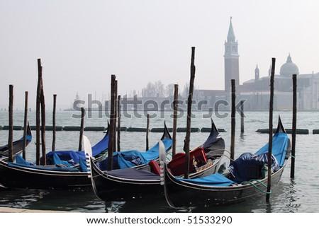 Gondolas tied up along the Grand Canal, Venice, Italy - stock photo