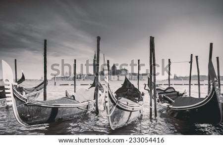 Gondolas with black and white effect at the Piazza San Marco, Venice, Italy. - stock photo