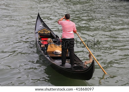 Gondolier and gondola - passenger transportation boats typical for Venice, Italy