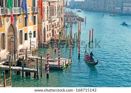 gondolier by Franchetti Palace in Venice, Italy - stock photo