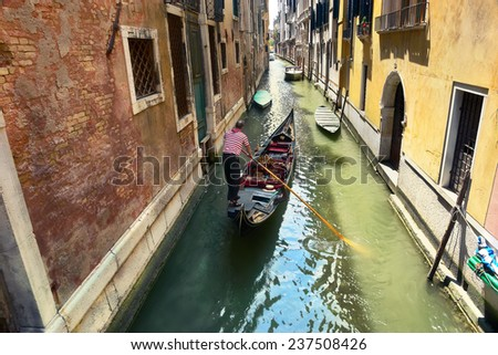 gondolier on the way to the grand canal, venice, italy - stock photo