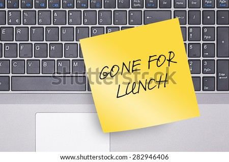 Gone for Lunch Note on Keyboard Concept Photo - stock photo