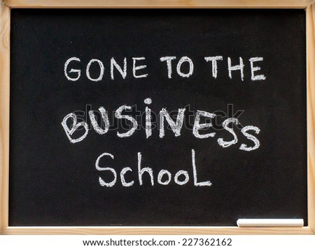 Gone to the business school message written with white chalk on wooden frame blackboard, business learning concept - stock photo