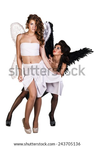 Good and evil. Sexy dark and white angels isolated on white - stock photo