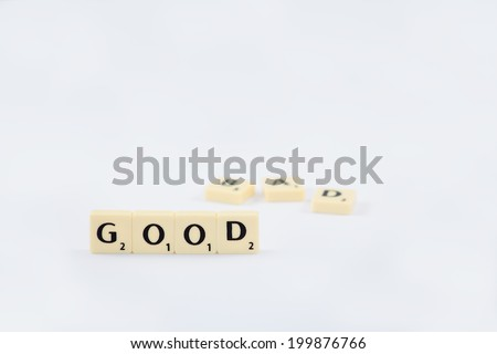Good-Bad. Two contradictory words on a white background, the positive word in focus and the negative blurred. - stock photo