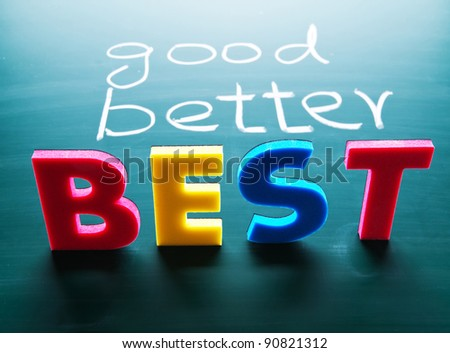 Good, better and best, colorful words on blackboard - stock photo