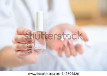 Good colour. Young girl demonstrating her favourite nail polish colour.  - stock photo