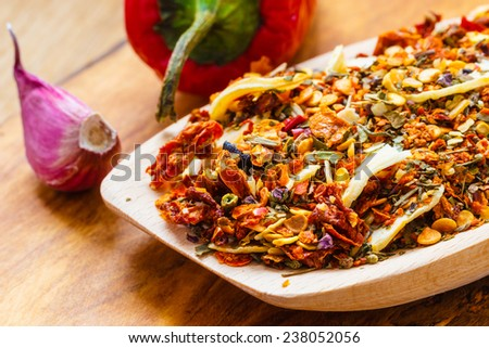 Good cuisine. Closeup colored spices for pasta mix cooking ingredients on wooden spoon