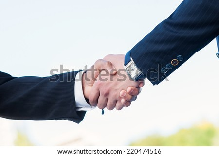 Good deal. Two confident businessman shaking hands in formalwear - stock photo