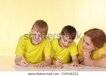 Good family in yellow t-shirts having a good time together