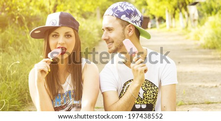 Good friends eating ice cream at the park - stock photo