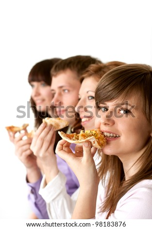 Good funny Caucasian campaign of four people eating pizza on a light background