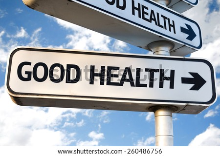 Good Health direction sign on sky background - stock photo