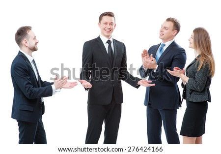 Good job! Partnership and congratulations. Cheerful businessman take up greetings from his colleagues. Isolated on white. - stock photo