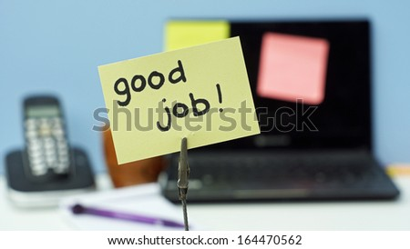 Good job written on a memo in a office                       - stock photo