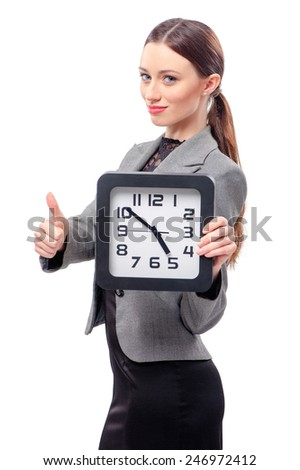 Good job! young attractive caucasian business woman holding office clock, isolated on white background - stock photo