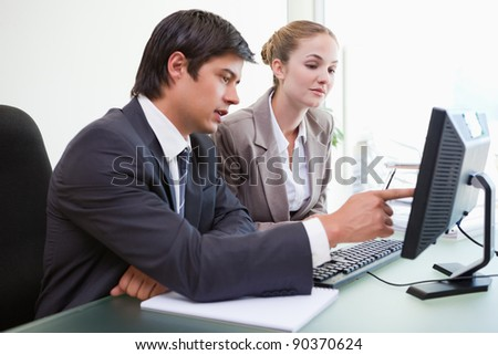 Good looking business people working with a computer in an office